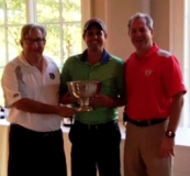 Grand Commodore Alan Stockmeister presents a trophy to the 2016 Golf Outing Champions
